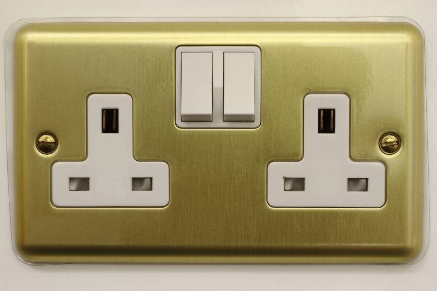 A Type G Power socket in gold and white