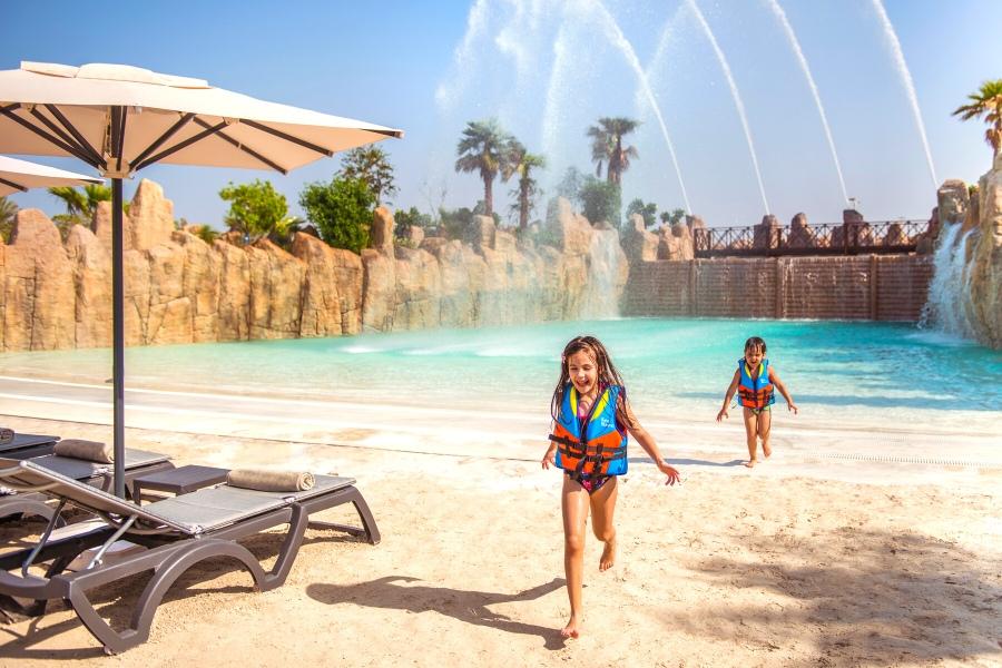 Kids playing in pool at Rixos Saadiyat Island family resort in Abu Dhabi