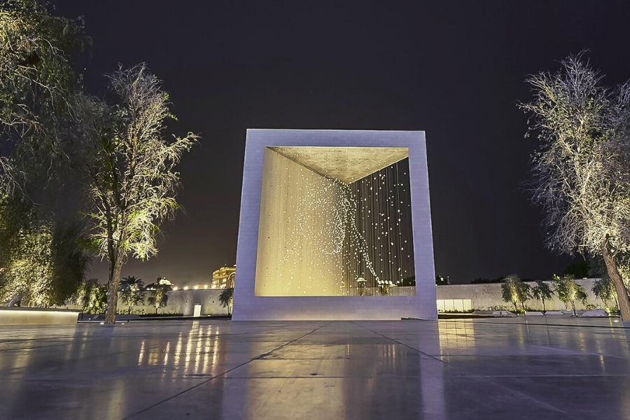 Founders memorial Abu Dhbai lit up at night