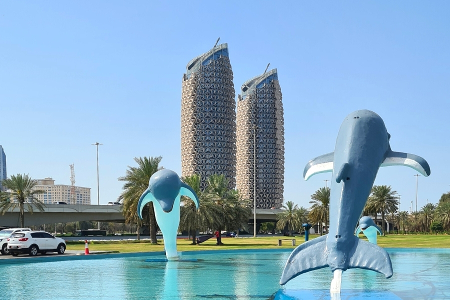 Dolphin park in front of Al Bahar Towers