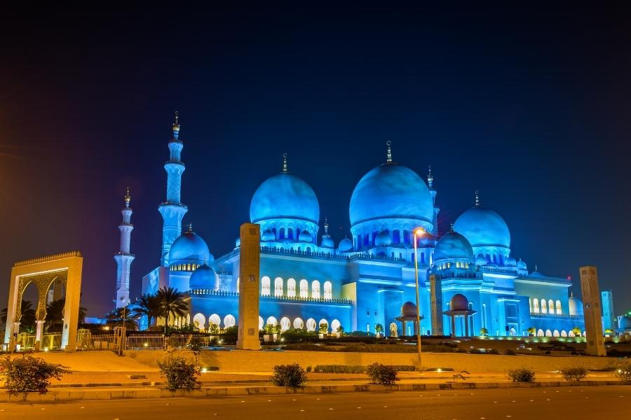 Sheikh Zayed Grand Mosque Abu Dhabi lit up blue at night