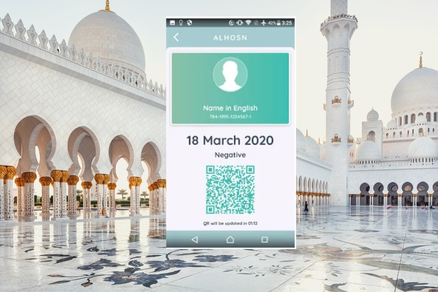 A picture of the Al Hosn App superimposed on the Grand Mosque Abu Dhabi