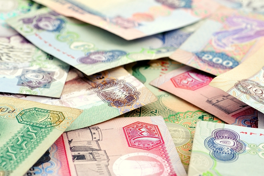 A pile of dirham notes from the UAE