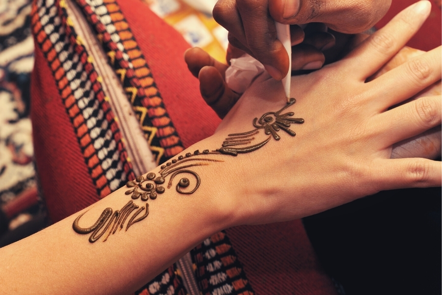 Traditional henna being applied at desert camp